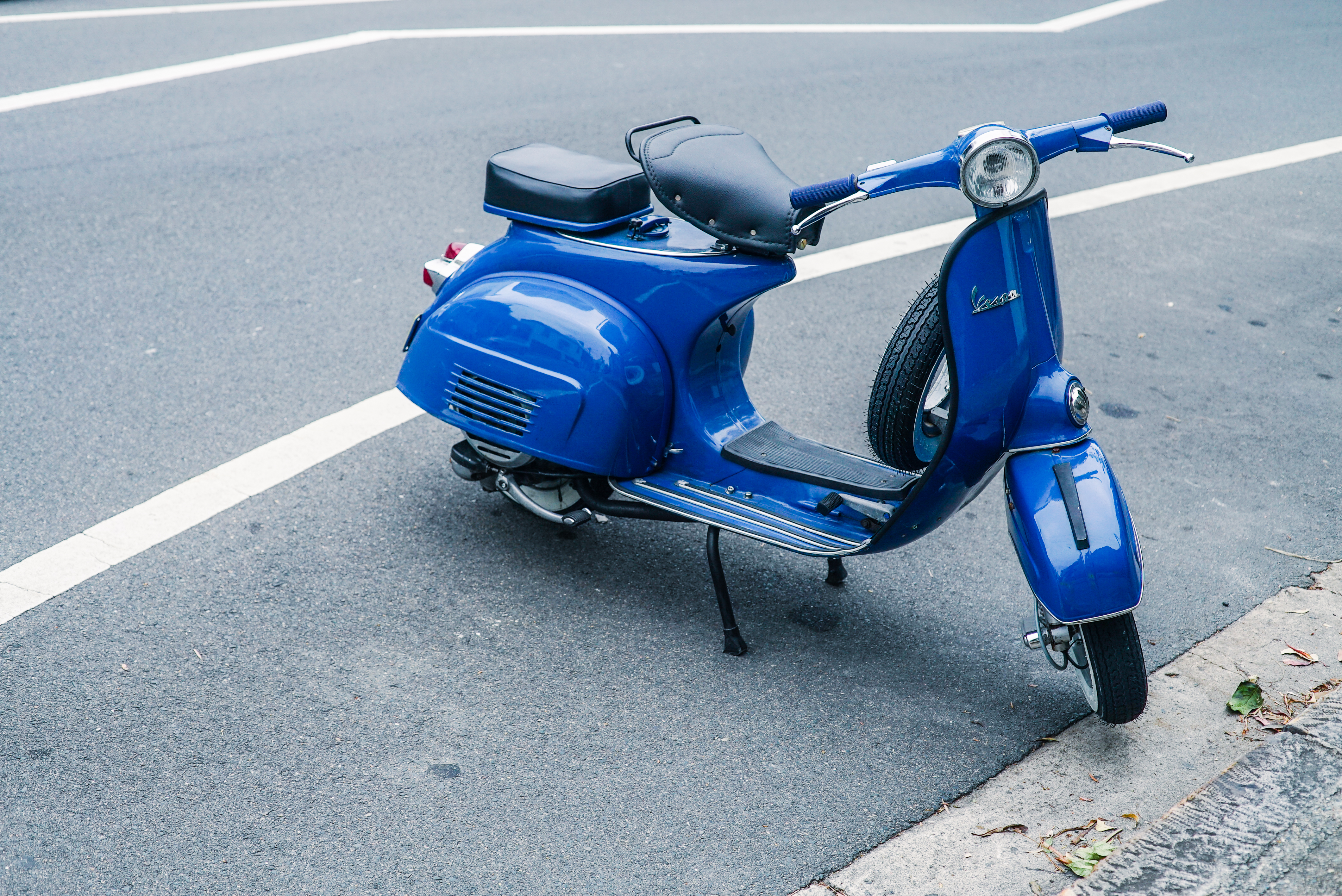 Parked Blue Motor Scooter