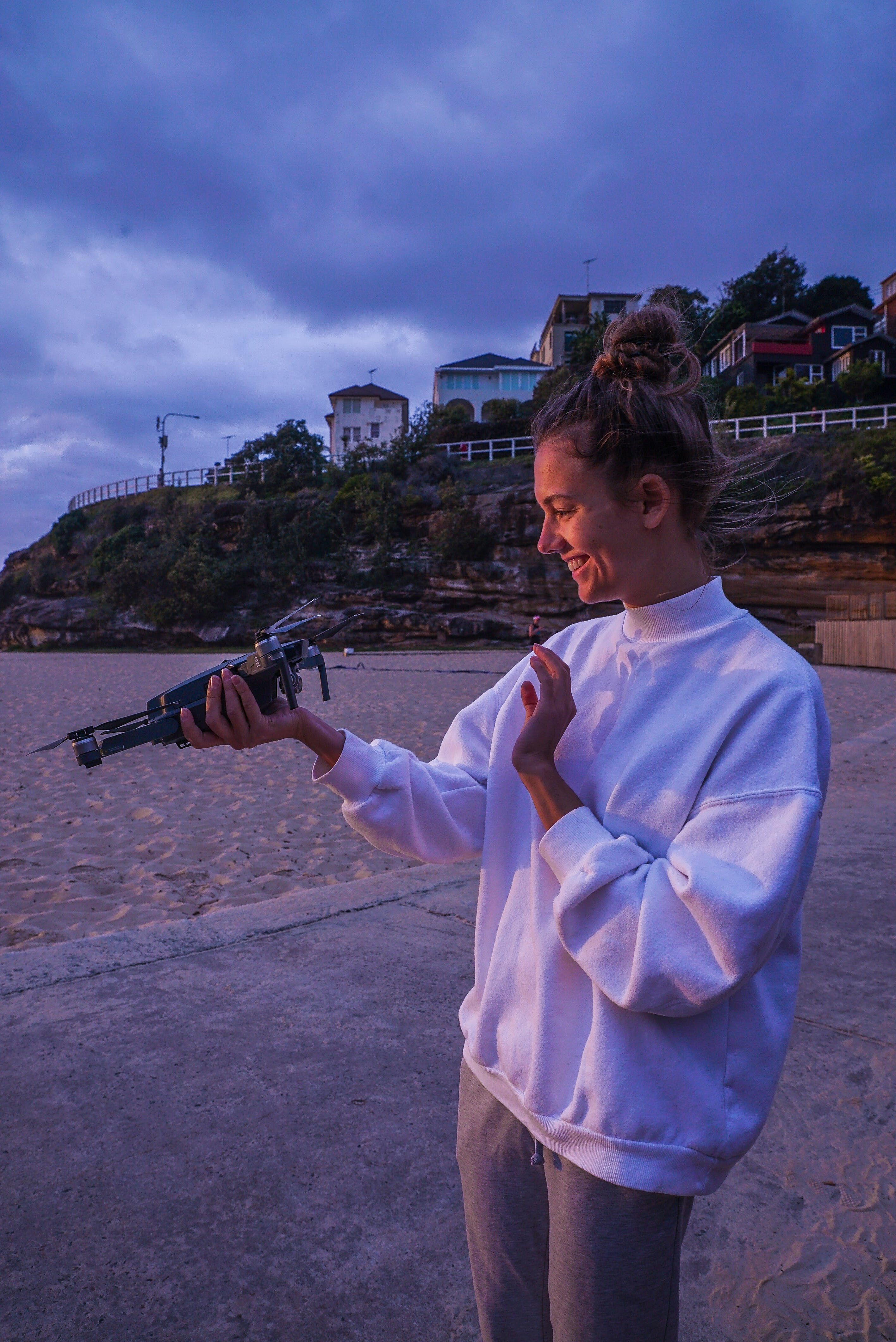 Photo of Woman Holding Drone