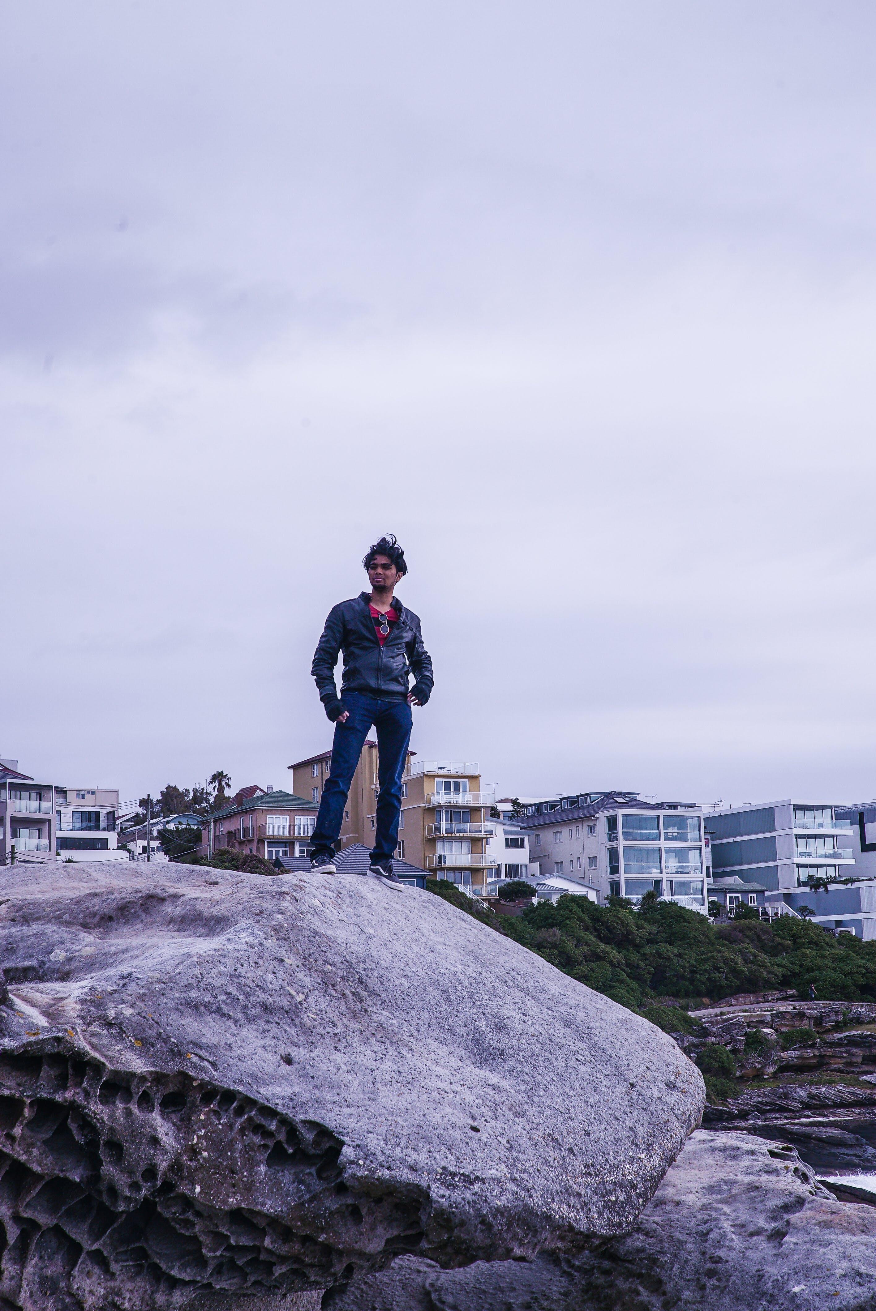 Man Standing on Gray Rock