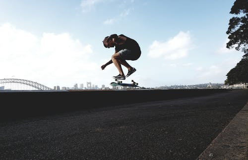 Photo of Man Doing Skateboard Trick