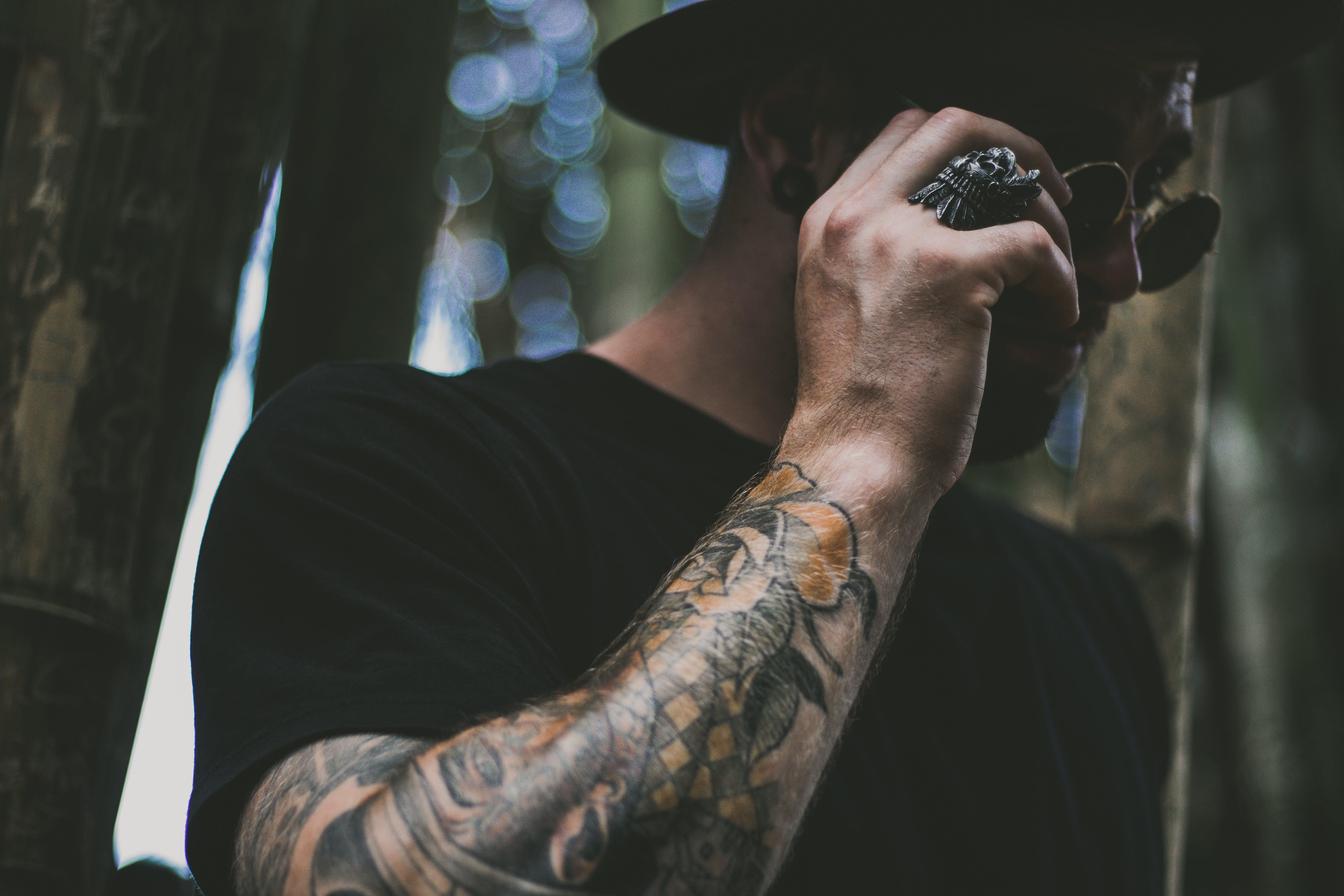 Photo of Man Holding His Sunglasses