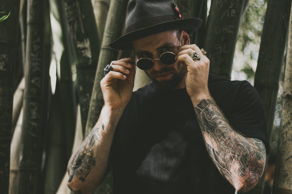Man Holding His Hippie Sunglasses