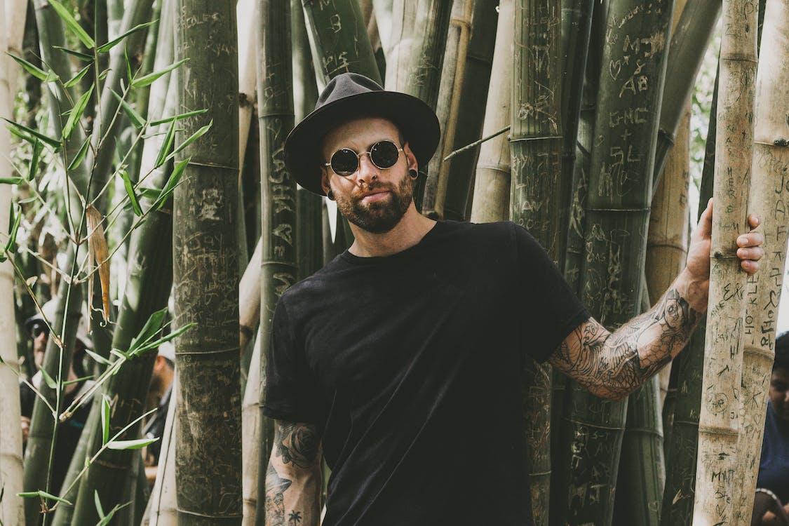 Photo of Man Standing Near Bamboo Trees