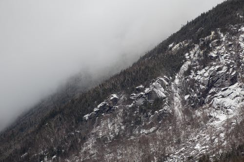 Mountainside With Snow And Fog