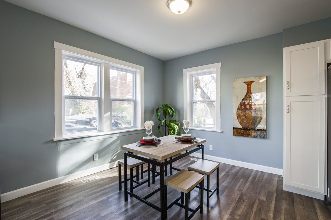 Brown Wooden Dining Set Under White Ceiling Lamp Beside Window and Door