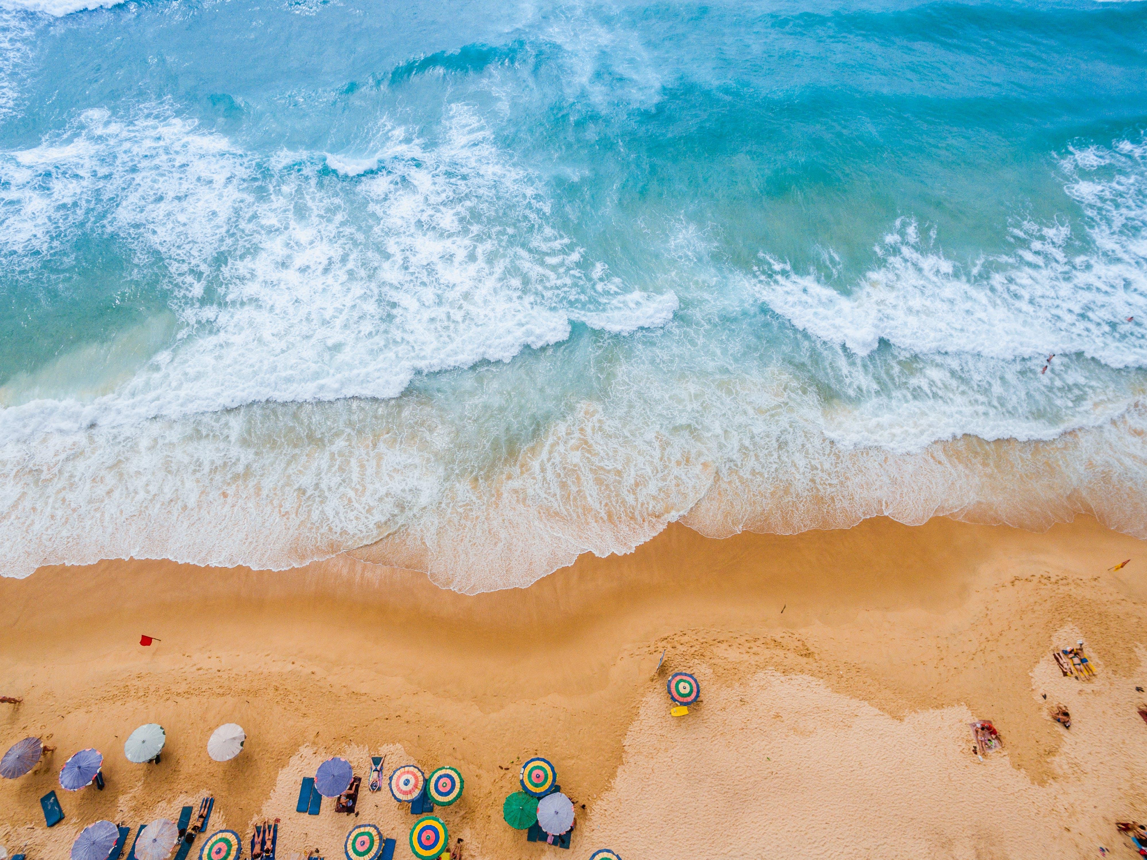 Fotos de stock gratuitas de agua, arena, azul, centro turístico