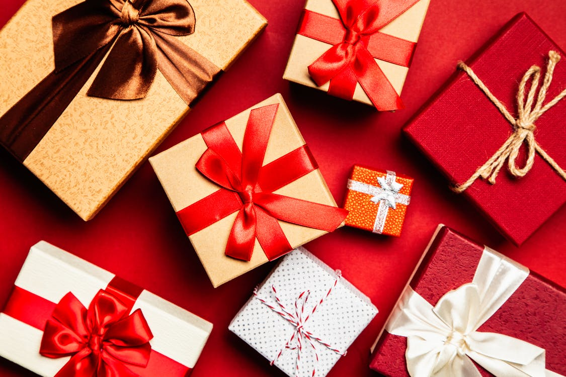 Assorted Gift Boxes on Red Surface