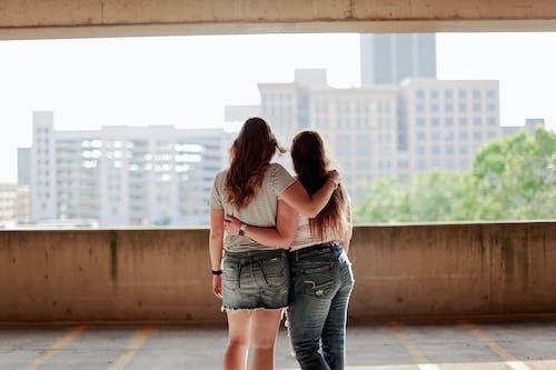 Two Women Standing Inside Parking Lot
