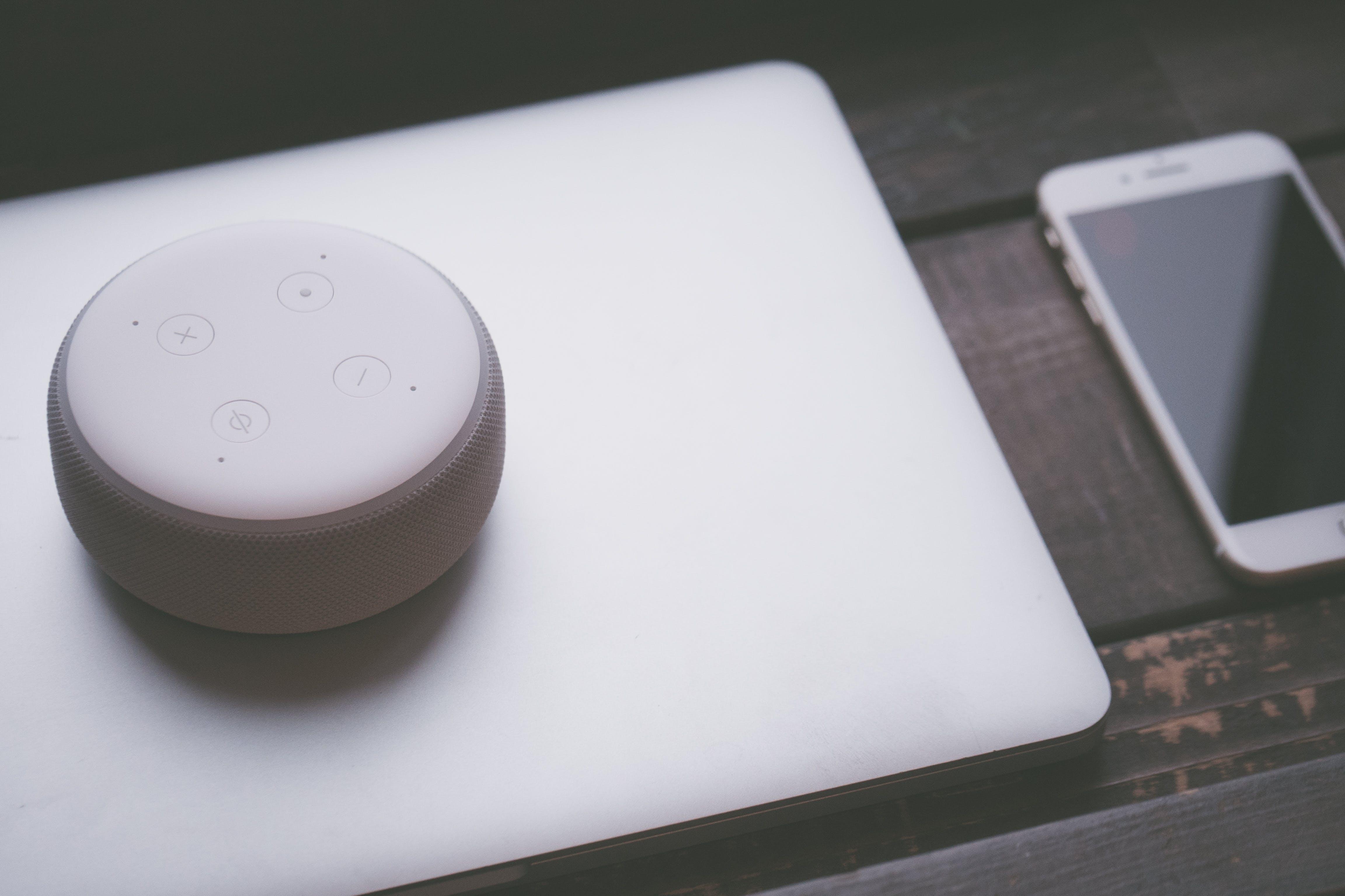 White Bluetooth Speaker On Silver Laptop Computer
