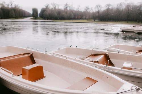 White Boats On Body Of Water