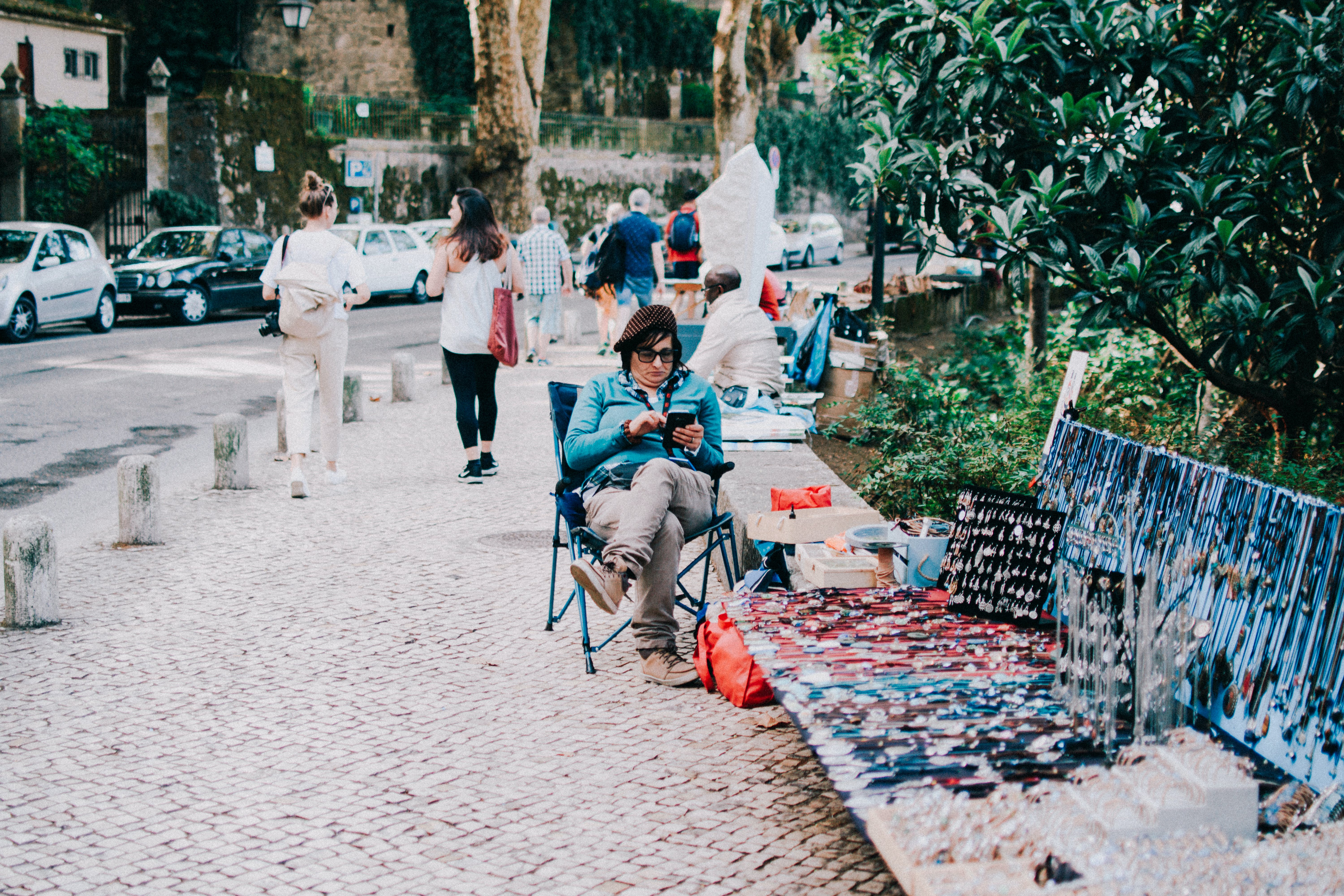Person Sitting on Camping Chair Near Displayed Products