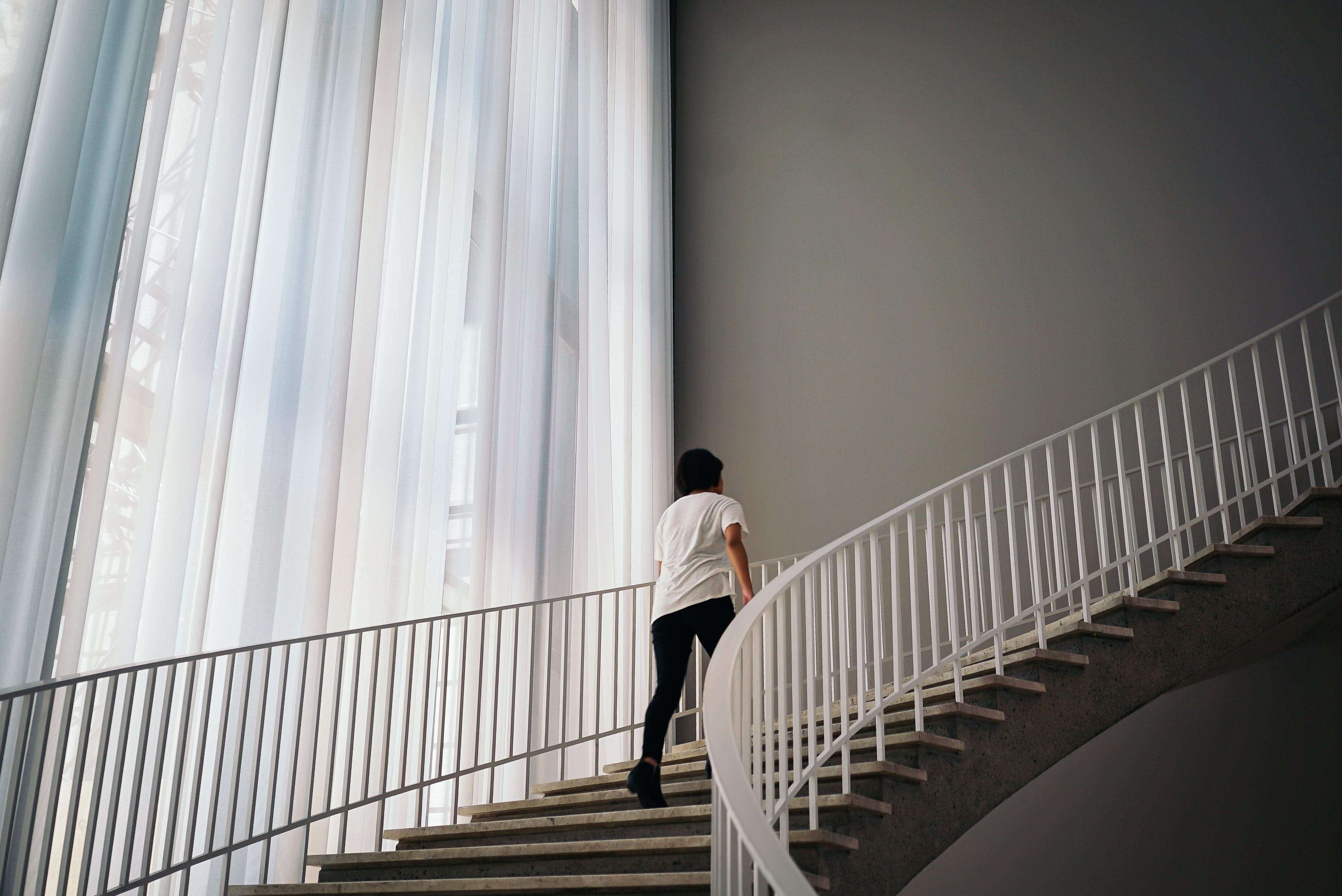 Person Walking On Stairs Inside Building