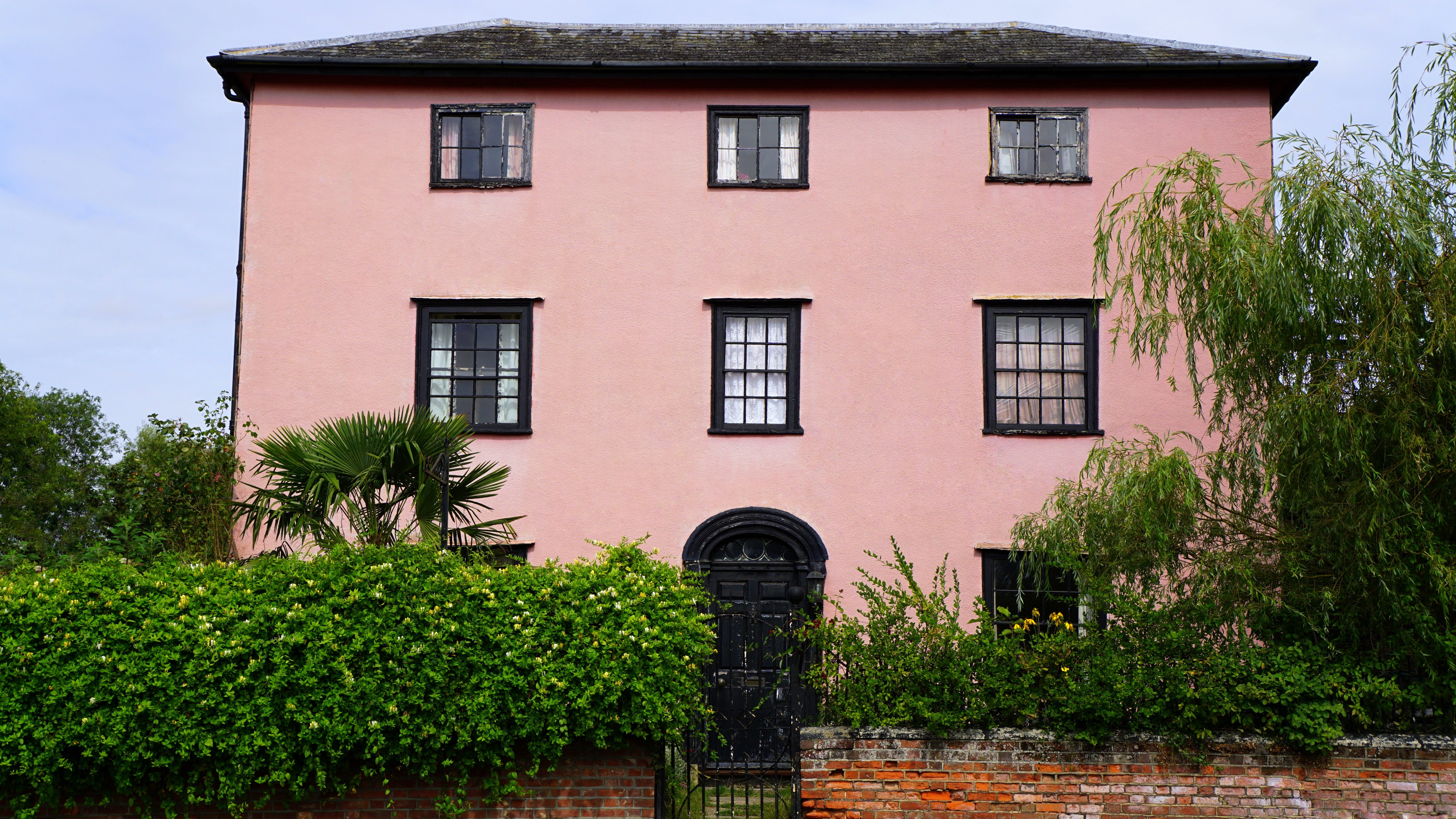 Pink House Facade With Black Gate