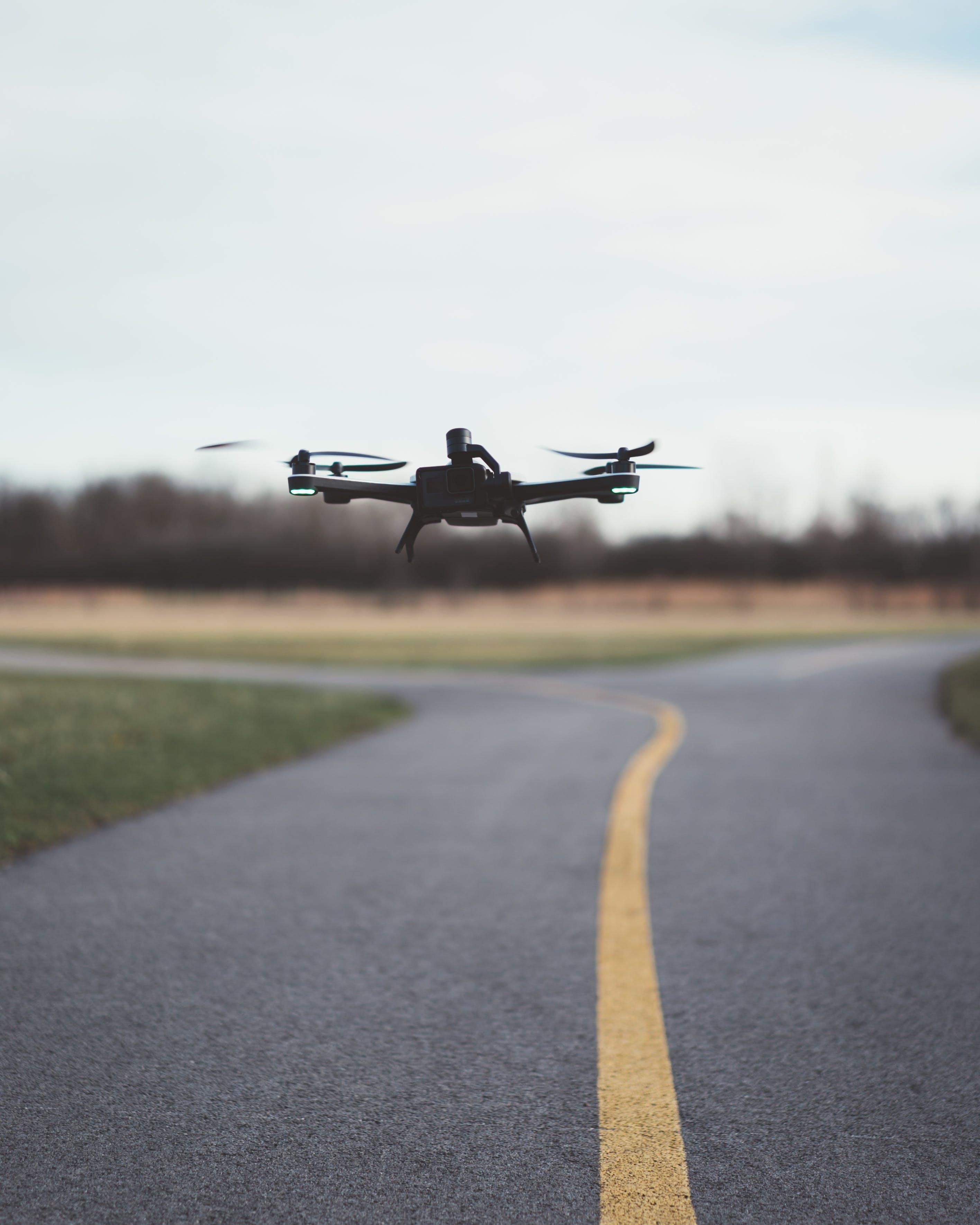 Foto profissional grátis de câmera, drone, macro, voando
