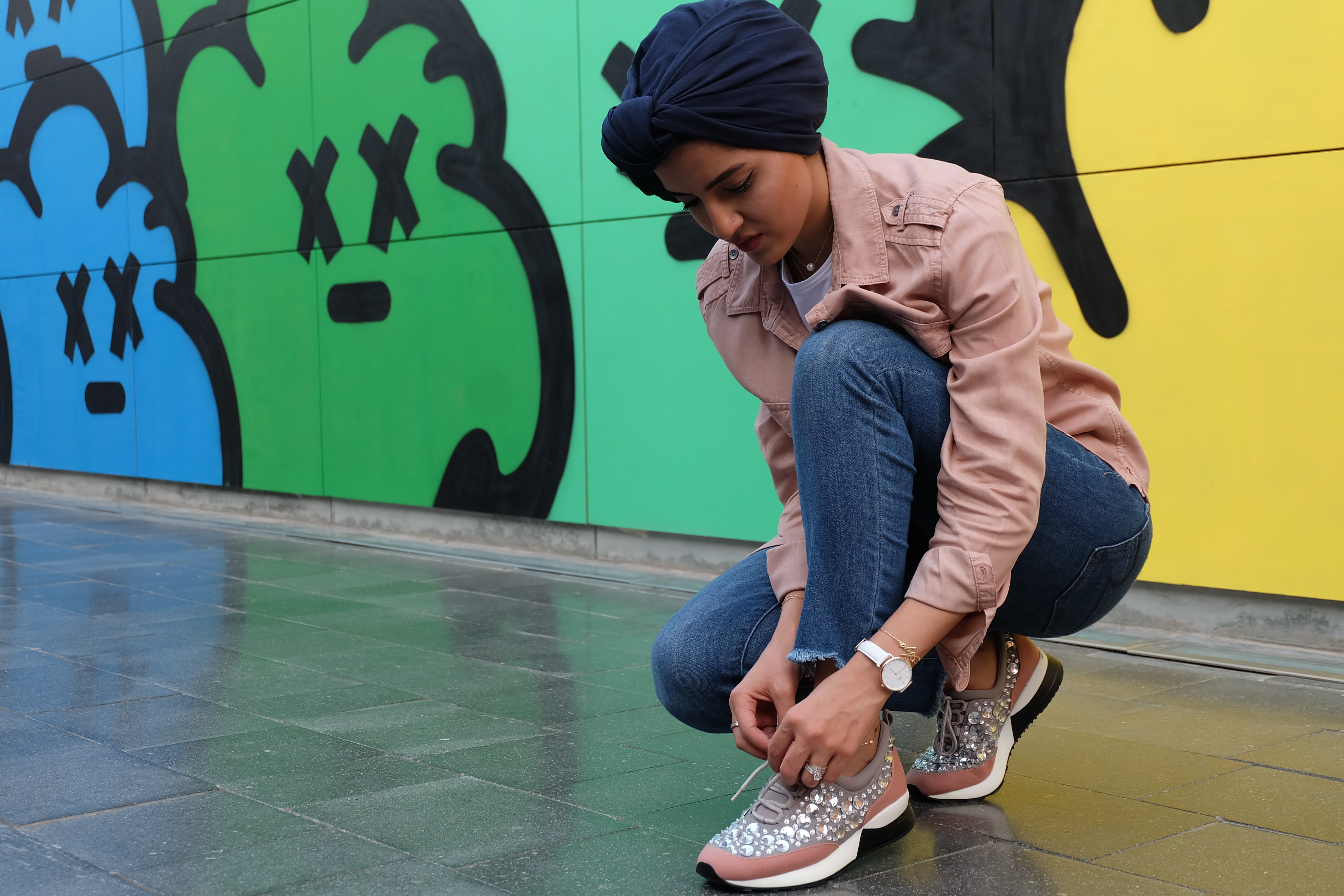 Photo of Woman Tying Her Shoes