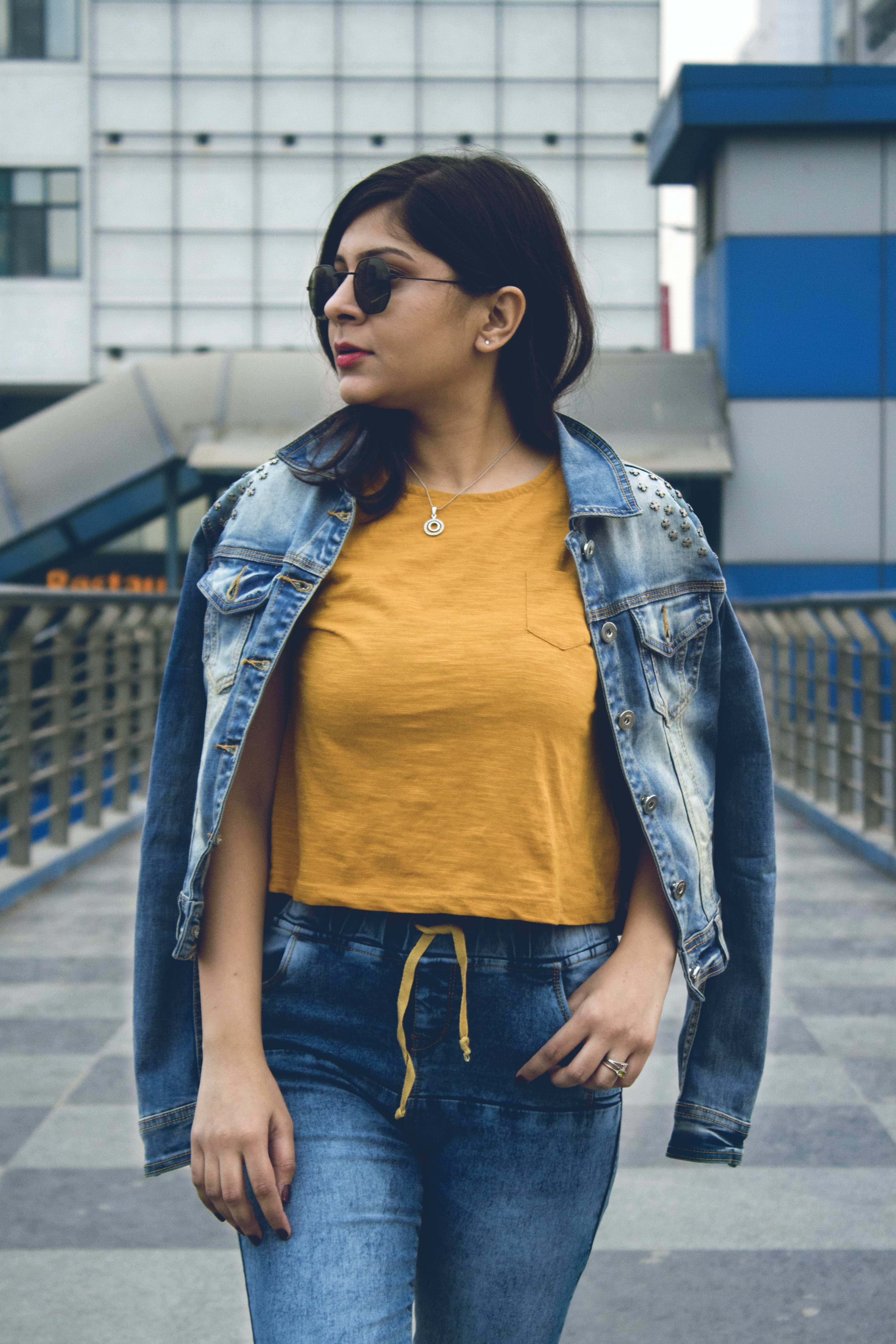 Photo of Woman Wearing Denim Jacket