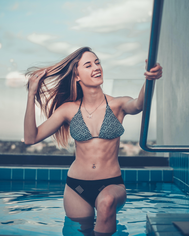 Woman Climbing Up Into Pool