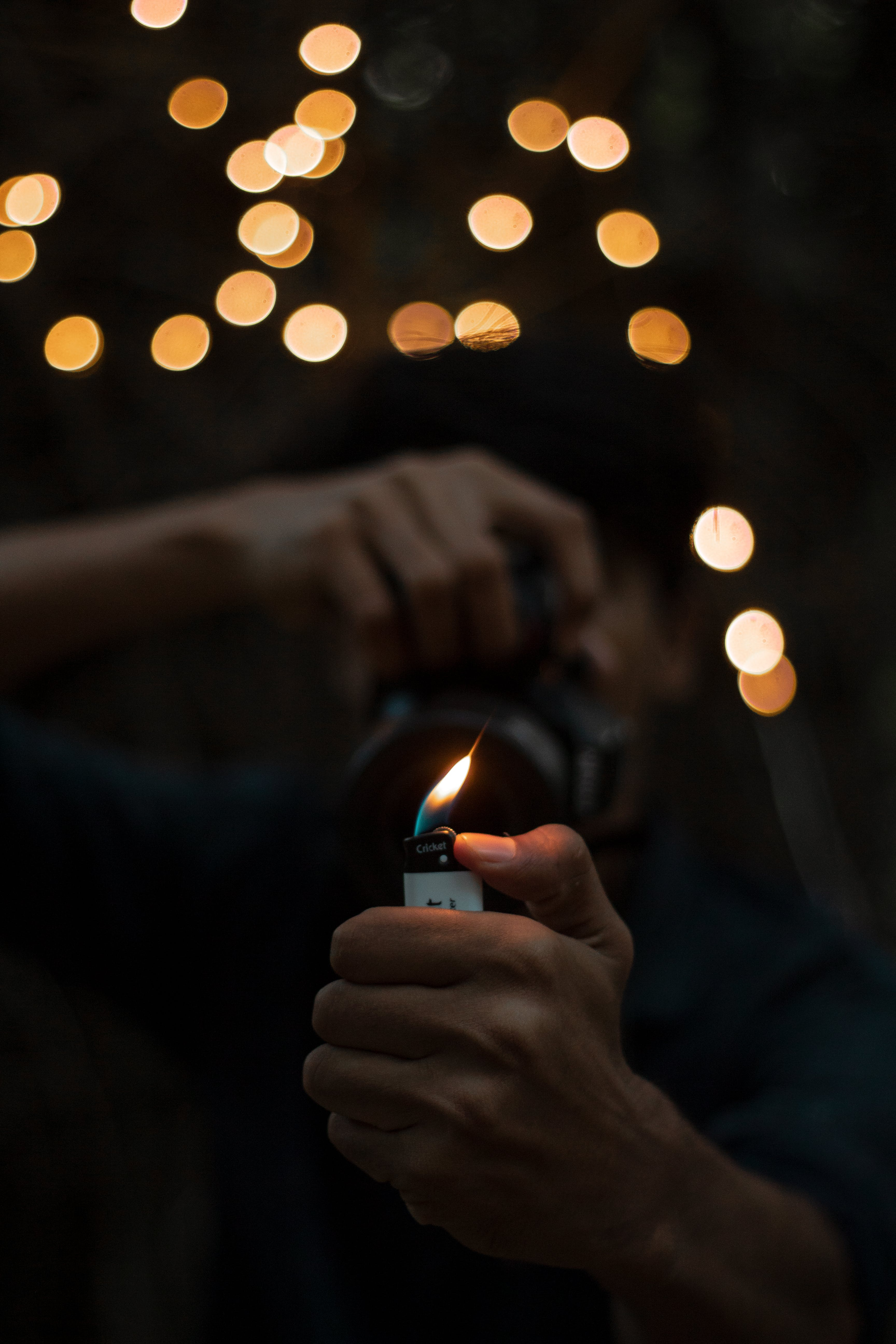 Person Holding Lighted Disposable Lighter
