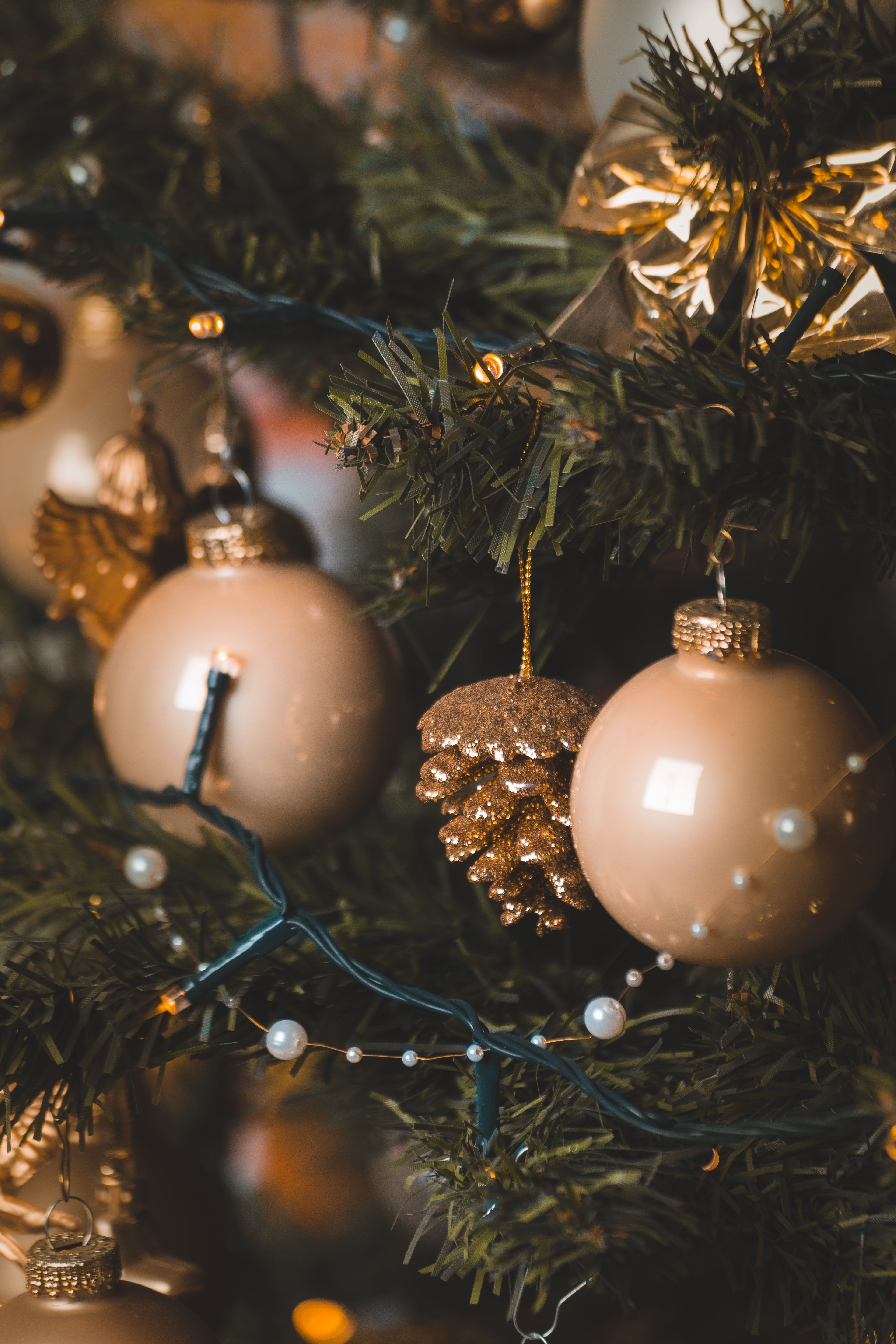 Beige Baubles and String Lights on Christmas Tree