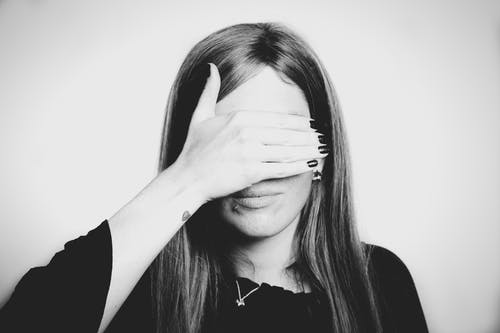 Grayscale Photo Of Woman Covering Her Eyes
