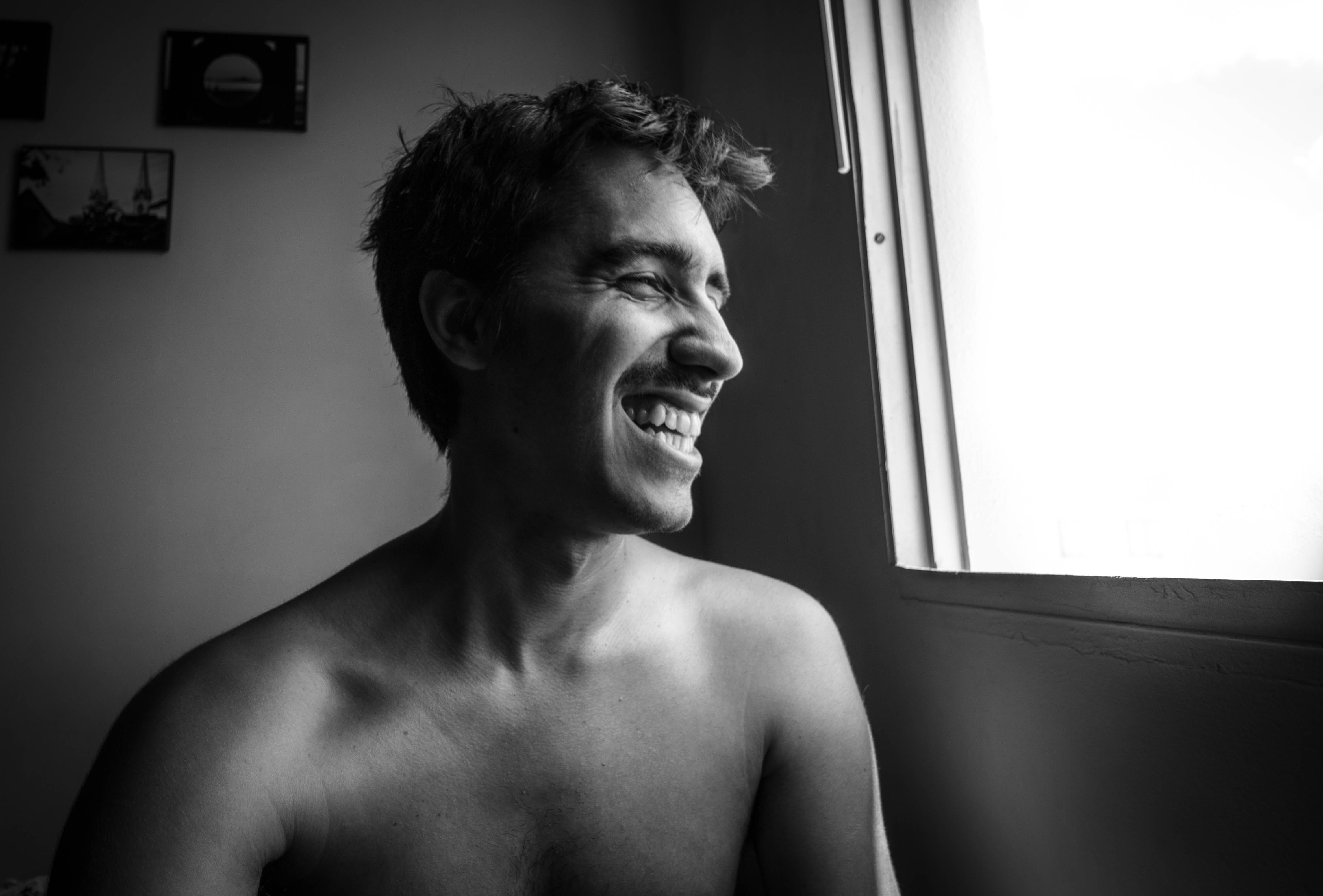 Grayscale Photography Of Smiling Man