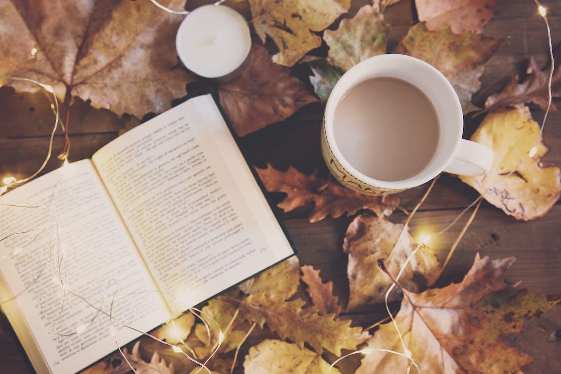 White Ceramic Mug And Book