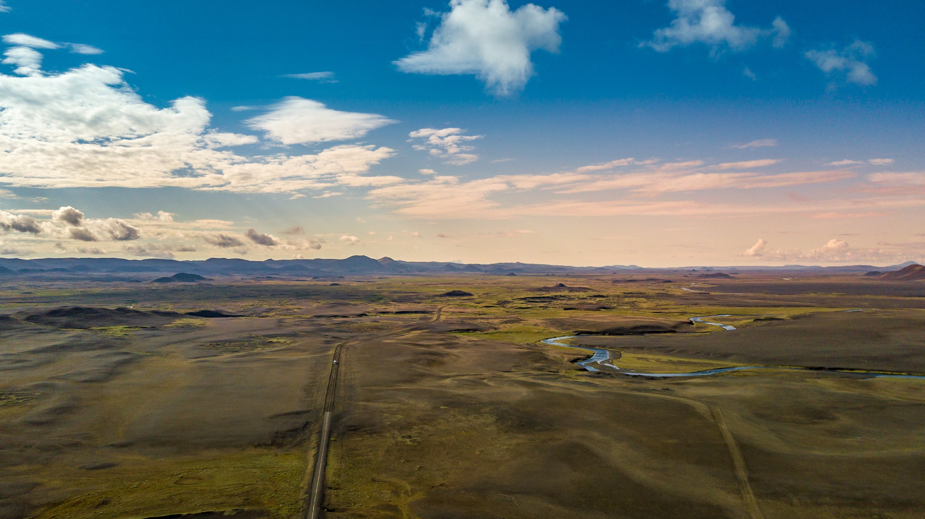 Free stock photo of amazed, clouds, dirt road, drone cam