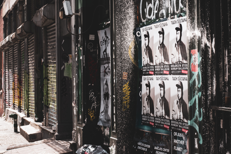 Posters on Wall Beside of Sidewalk