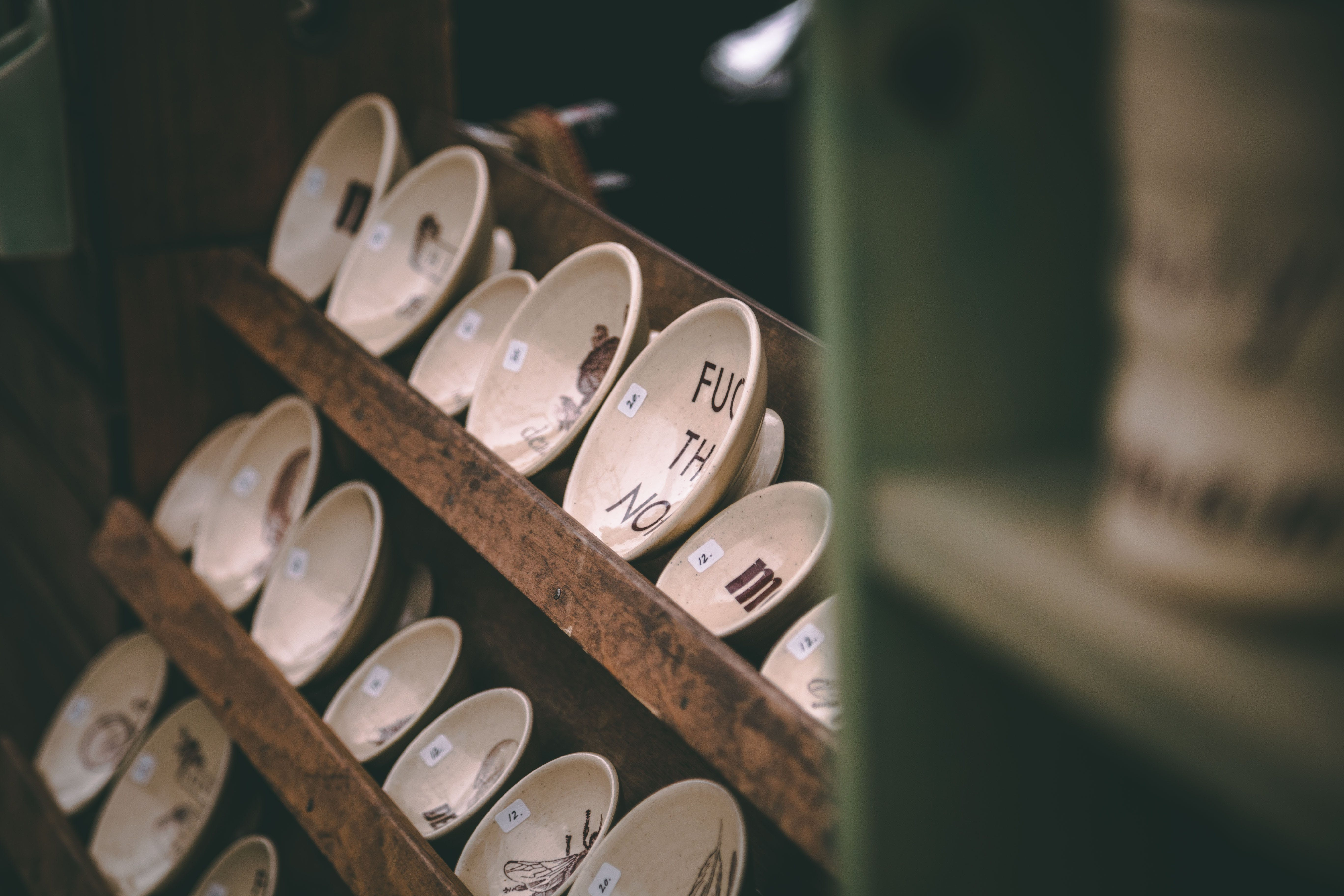 Photo of Saucers on Wooden Rack