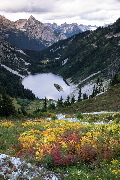 Lake Surrounded by Mountain Photography