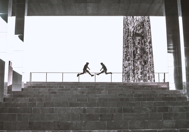 Two Person Jump Near Railings