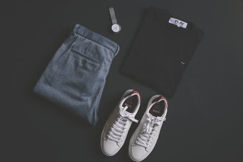 Pair Of White Shoes Beside Pants, Shirt, And Watch