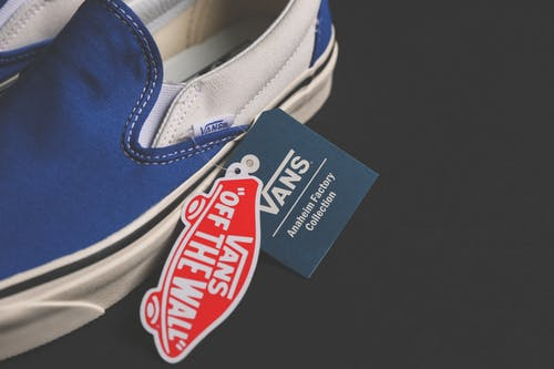 Unpaired White and Blue Vans Low-top Shoes