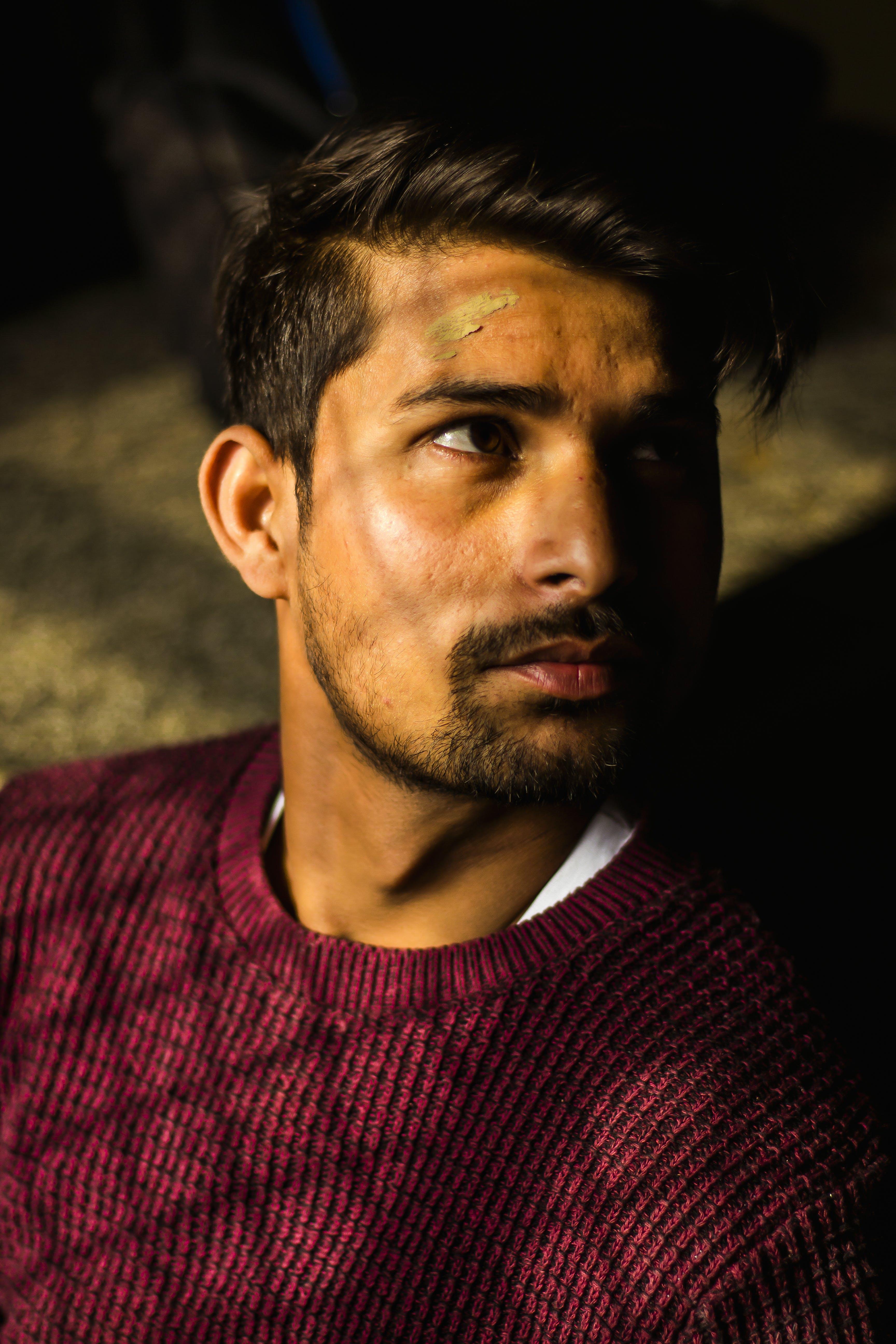 Photo of Man Wearing Maroon Sweater