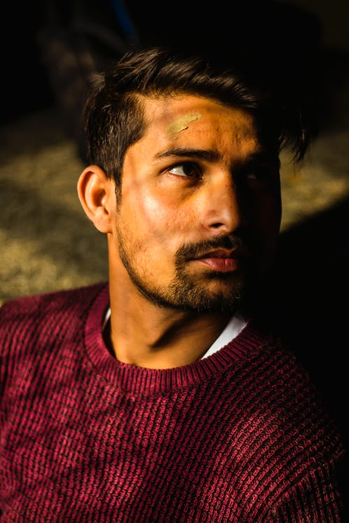 Photo of Man Wearing Maroon Sweater