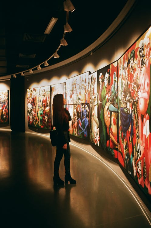 Woman Standing Near Paintings