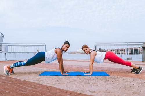 Two Women Doing Push-ups
