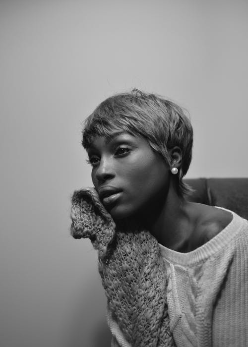 Grayscale Photo Of Woman Wearing Sweater