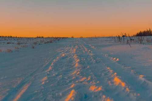 Photography of Snow during Golden Hour