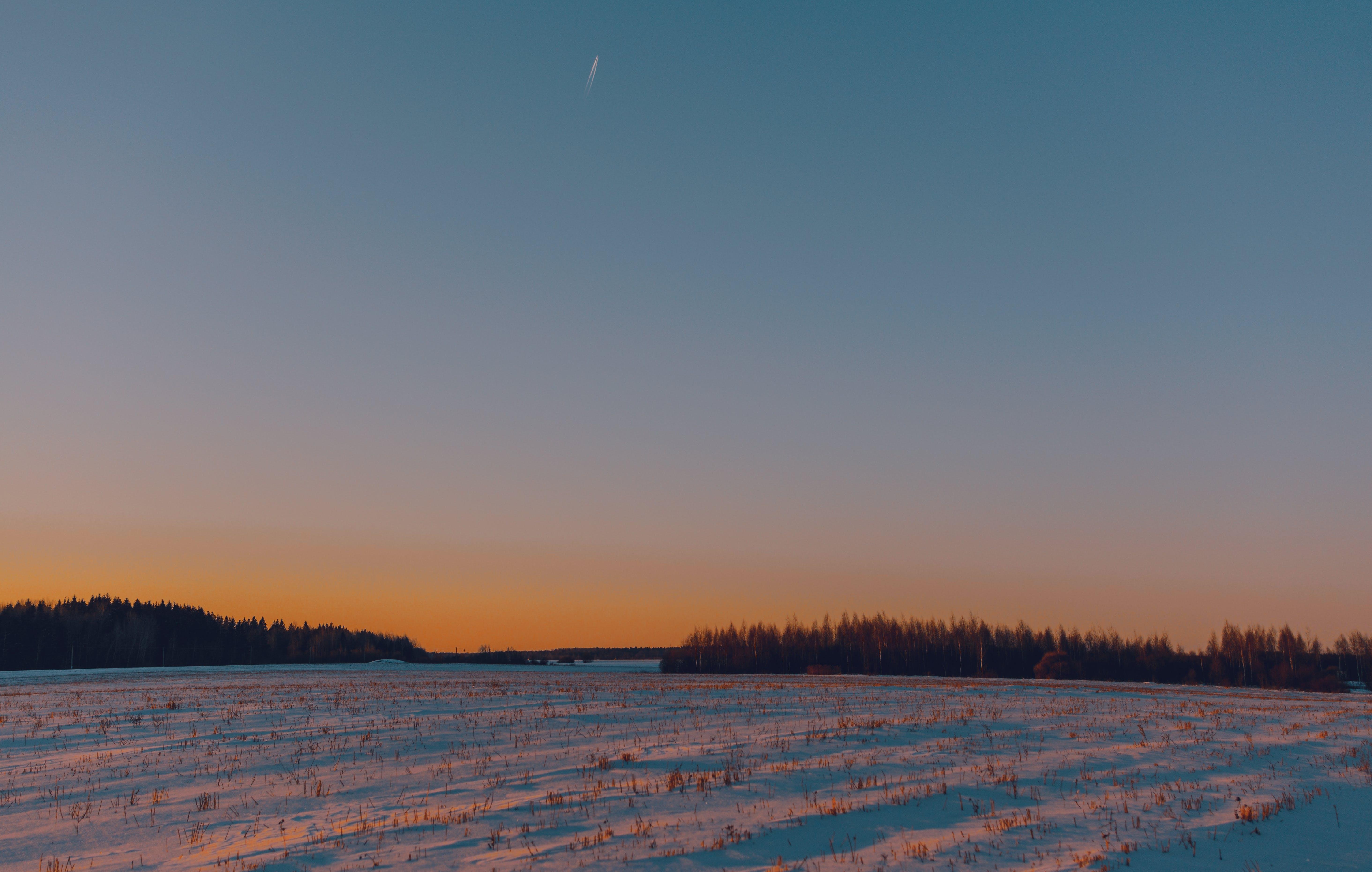 Kostenloses Stock Foto zu dämmerung, draußen, feld, himmel