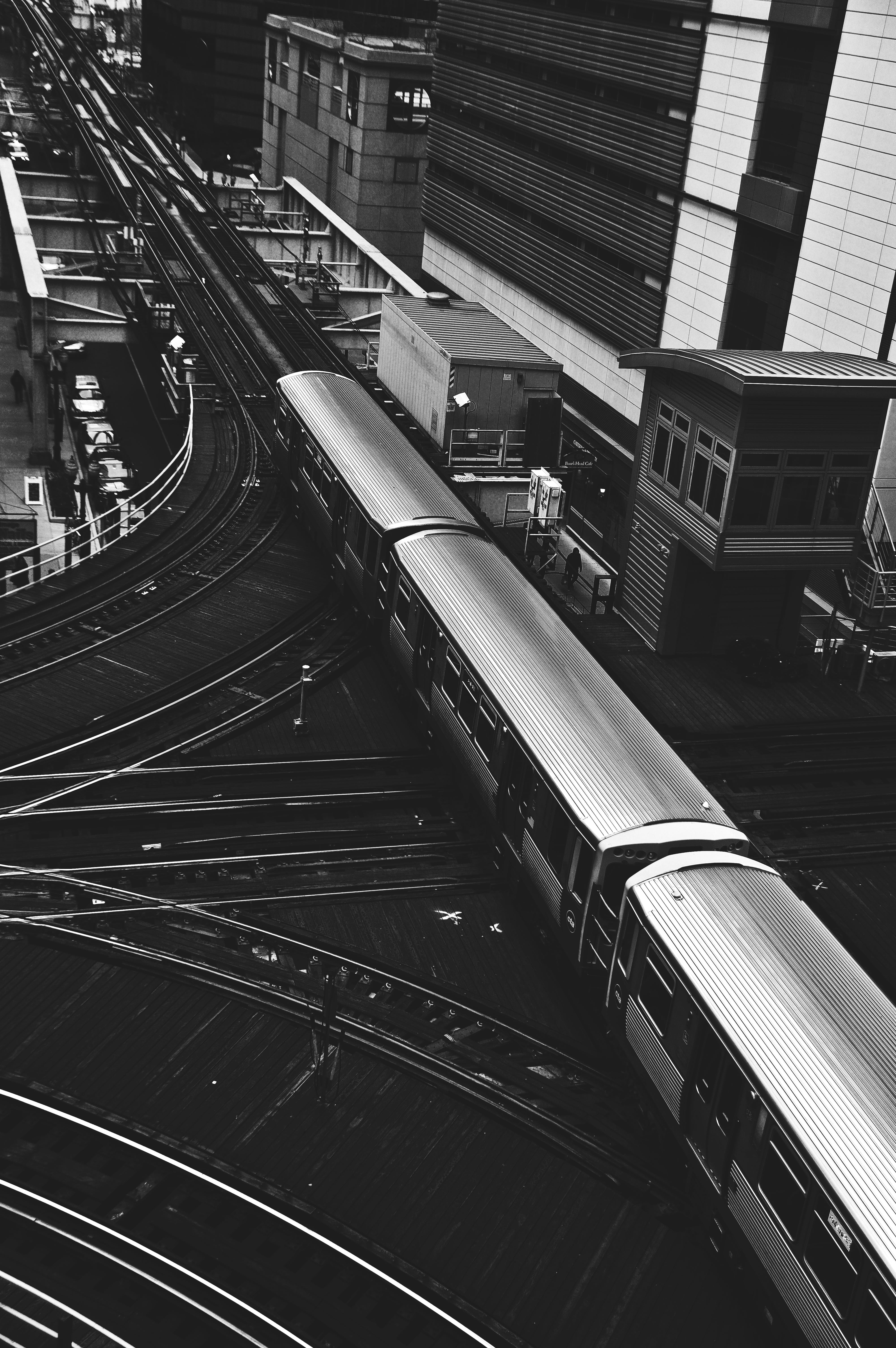 Grayscale Photography Of Train Beside Building