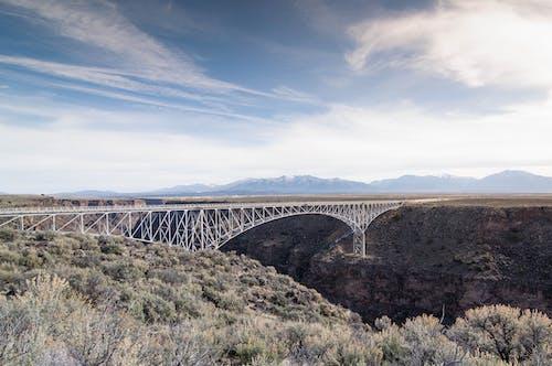 Landscape Photography of White Metal Bridge Under Blue Sky