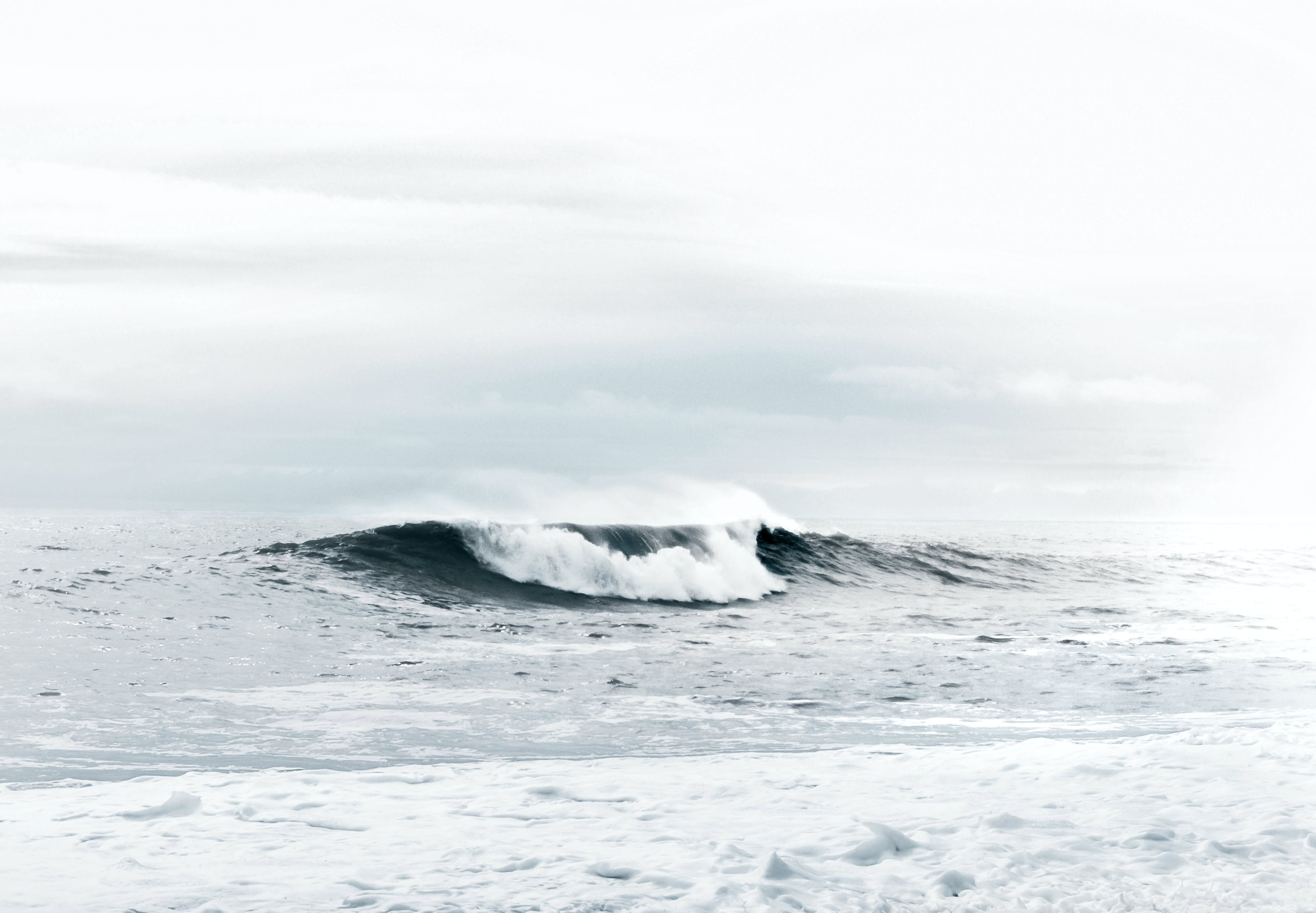 Photo of Sea Waves Under Cloudy Sky