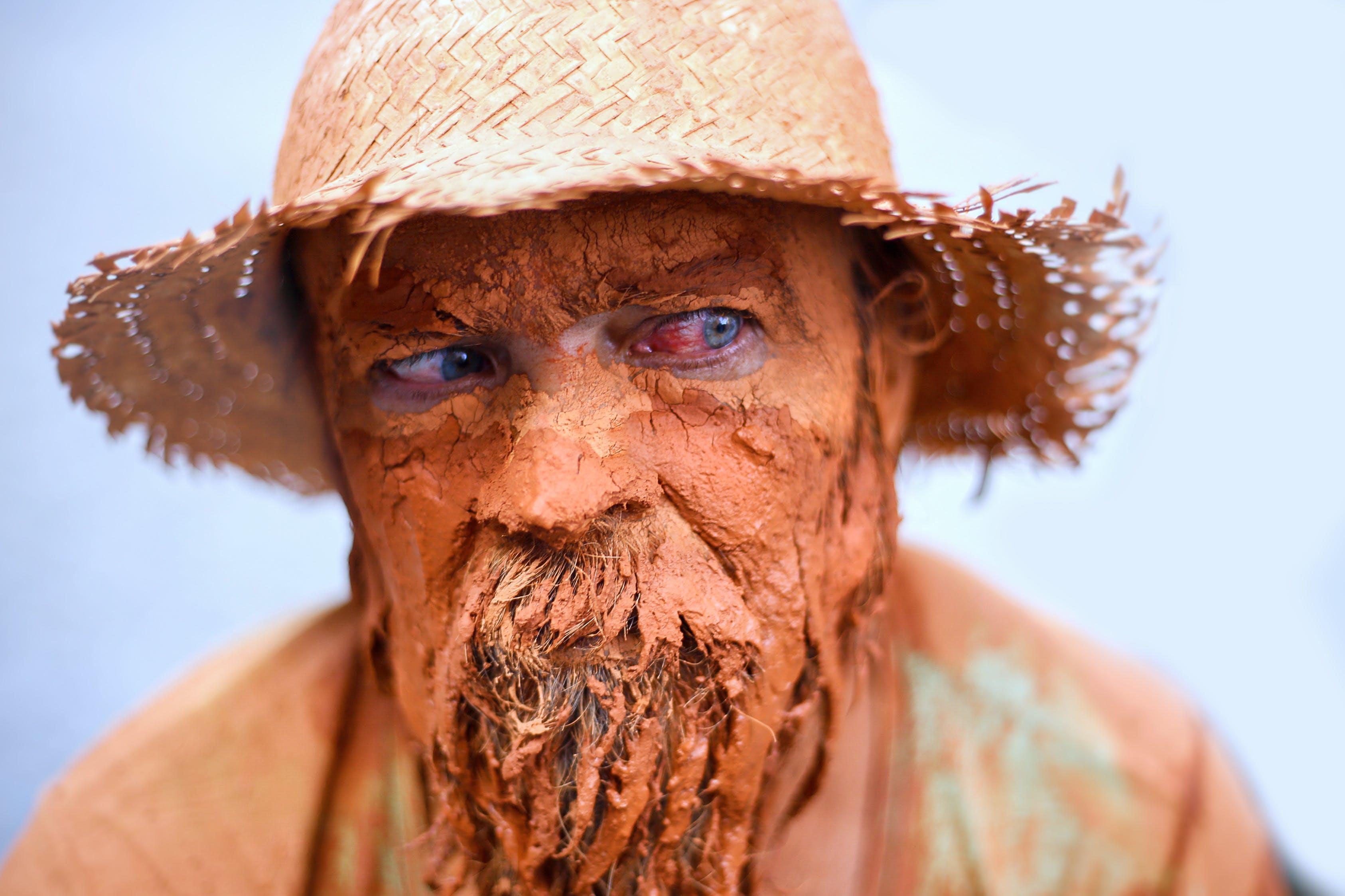 Person Wearing Brown Wicker Bucket Hat