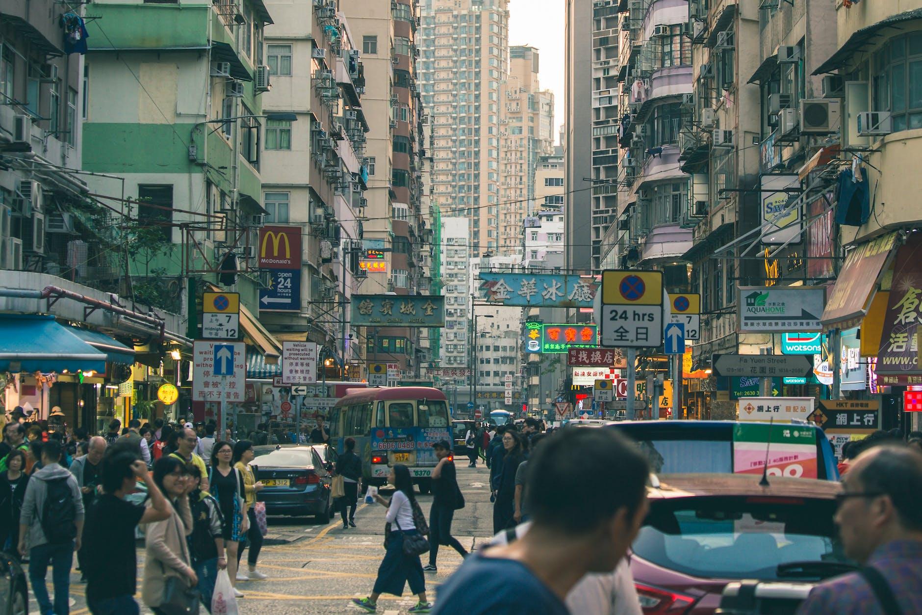 people on road between buildings