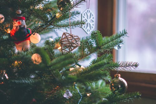 Selective Focus Photography Of Hanging Ornaments On Christmas Tree