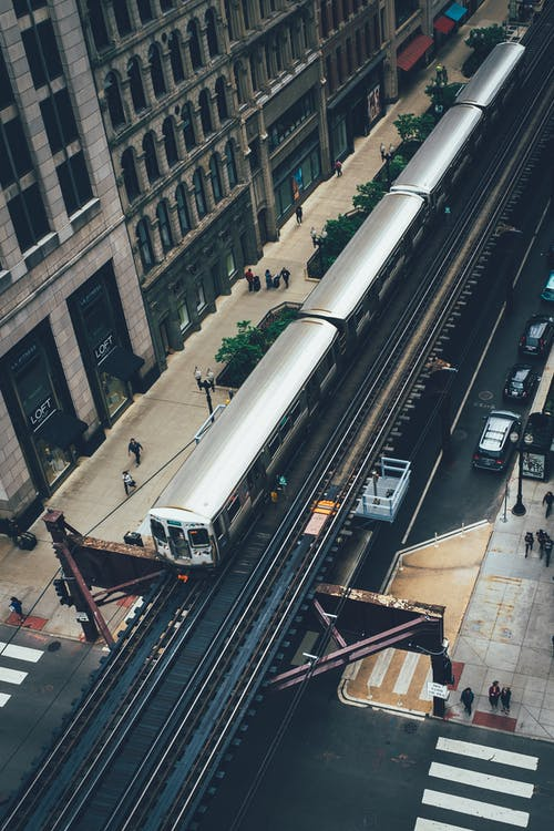 Aerial Photography of Gray Train Near Building