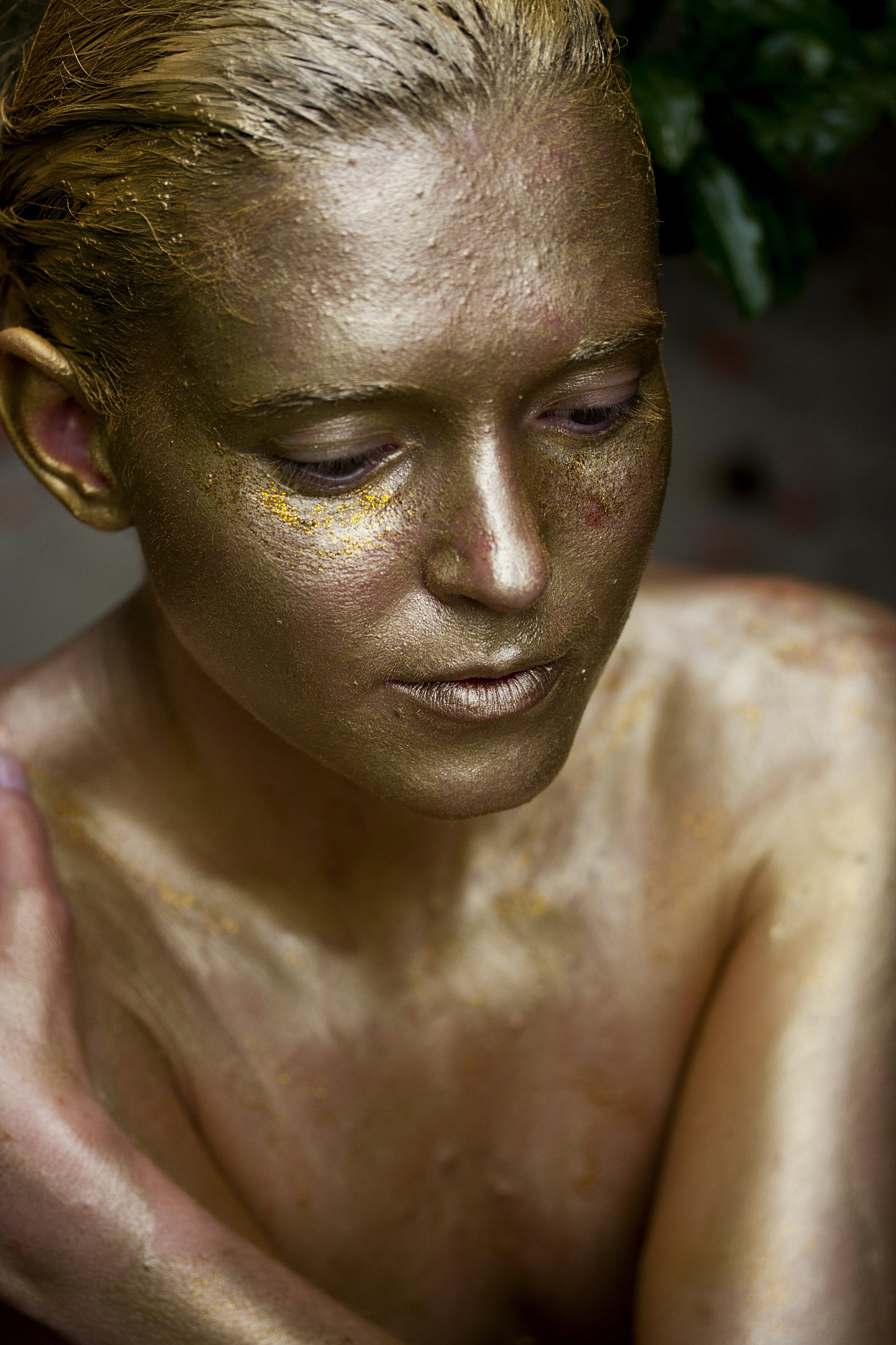 Woman Wearing Gold Body Paint