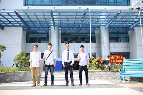 Four Men Standing Near the Building