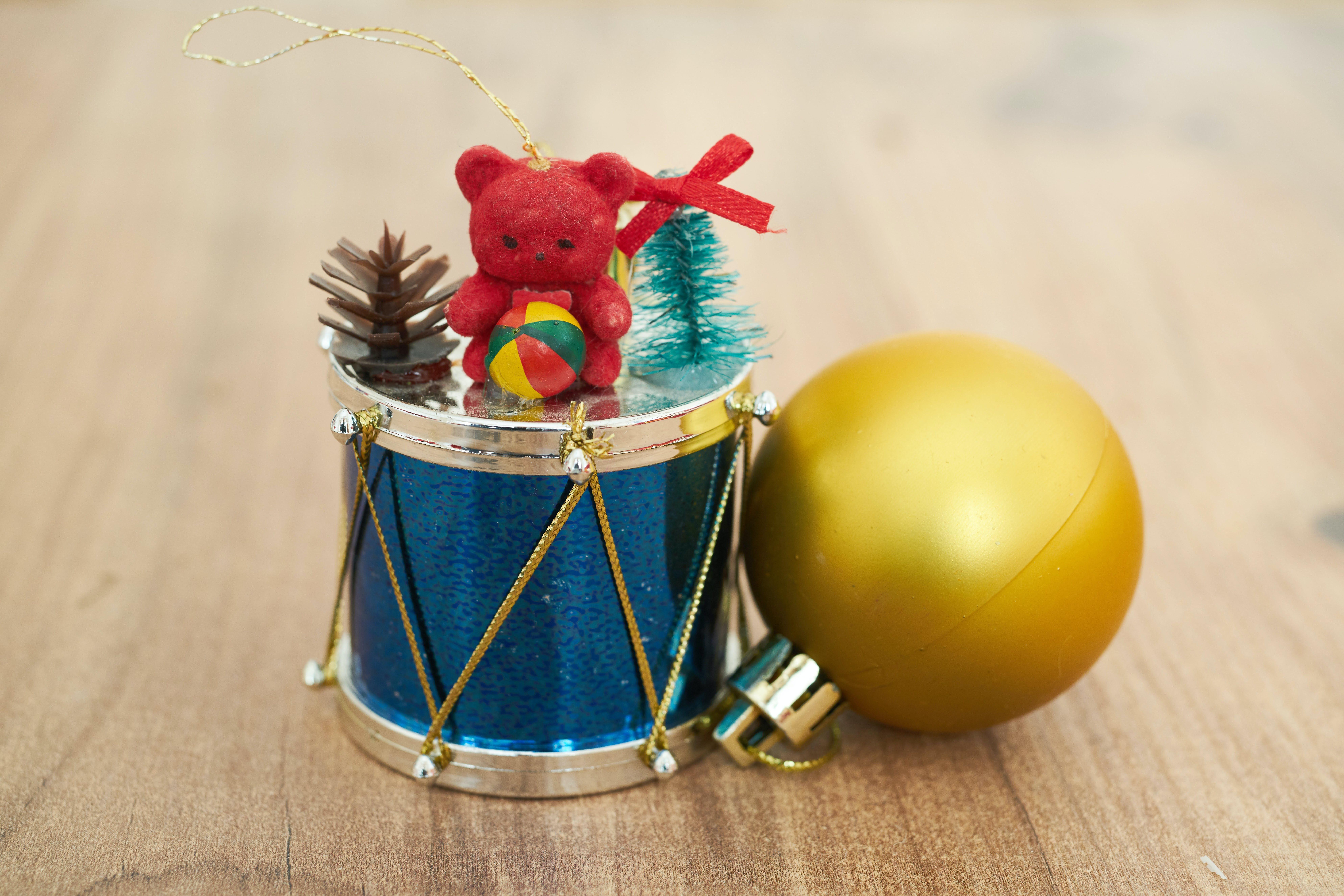 Blue Drum and Yellow Ornaments Placed on Wood